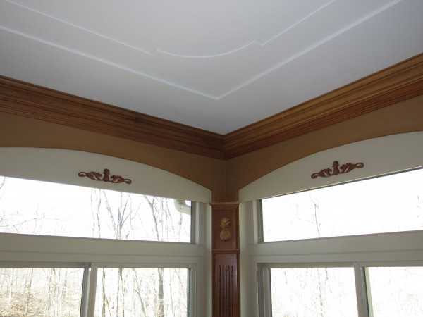 Sunroom layered drywall & arched valances